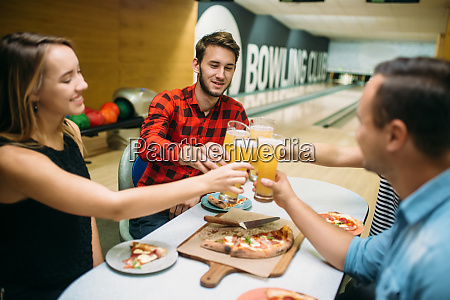 bowling team celebrate victory in the