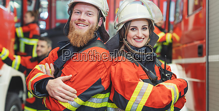 fire fighter man and woman standing