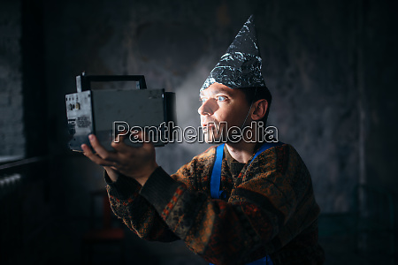 paranoid man in tinfoil cap mind