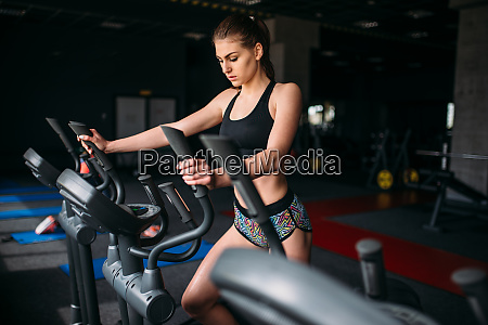 female athlete exercise on treadmill in