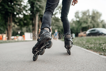 roller skating skater rolling back view