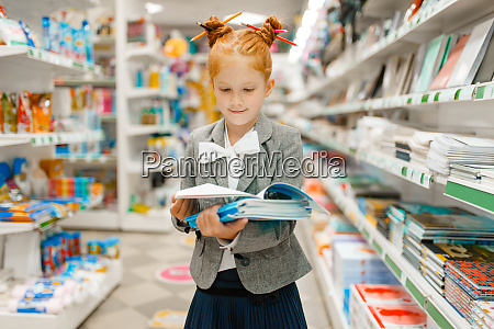 little school girl in stationery store