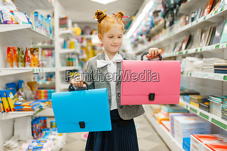 school girl with two folders in