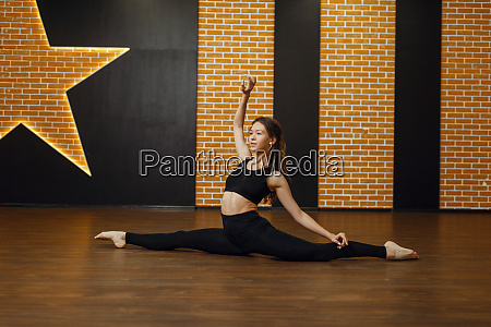 contemporary dance performer sitting on the