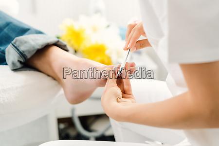 podiatrist working on mens feet