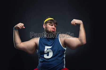 fat man shows his muscle