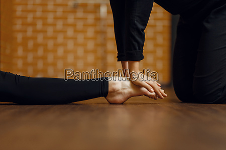 contemporary dance performer stretching on foot