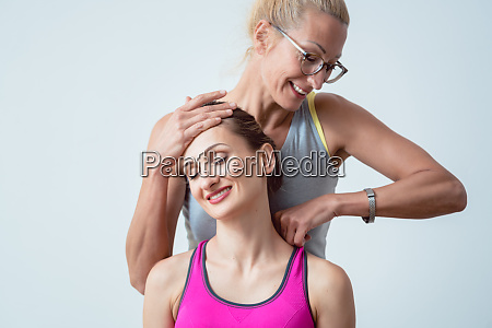 physical therapist working on head and