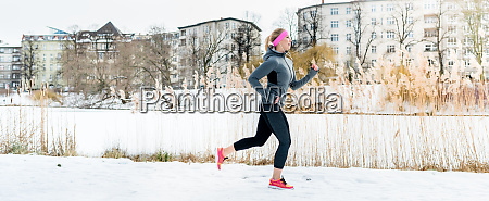 woman running for sport in front