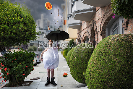 mad freak man walks with umbrella