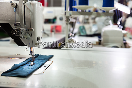 sewing machine on textile fabric closeup