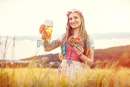 happy bavarian woman with beer and