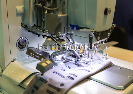 sewing machine closeup nobody clothing sew