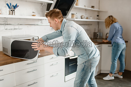 love couple prepares food for the