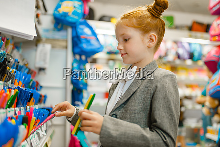 school girl choosing a pen in
