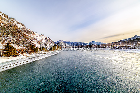 landscape with snow capped mountains and