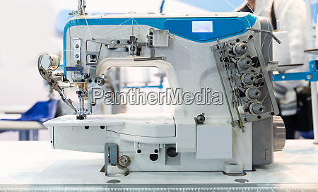 overlock machine closeup nobody clothing sew