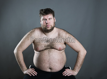 fat man isolated on gray background