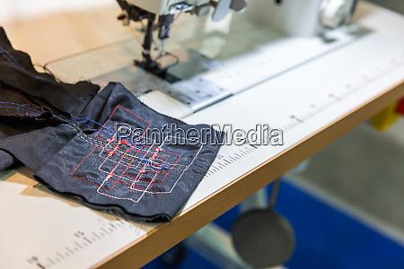 sewing machine in cutting shop closeup