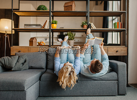 couple with books lying on the