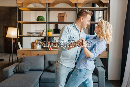 young love couple dancing at home