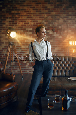 elegance business woman in strict clothes