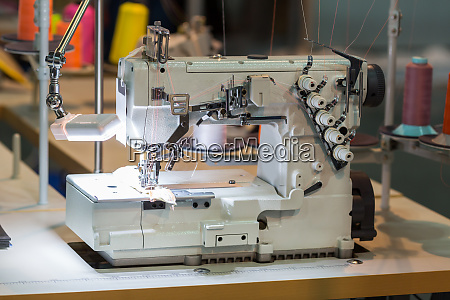 sewing machine and cloth in cutting