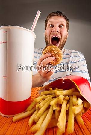 expressive man eating fast food
