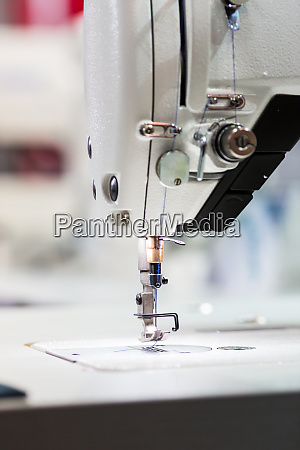 sewing or overlock machine closeup nobody