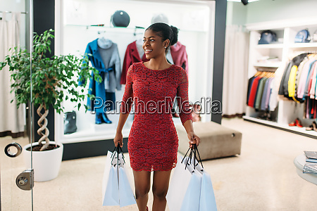 attractive black lady in red dress