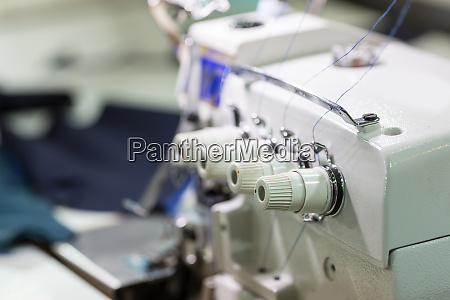 sewing or overlock machine closeup cloth