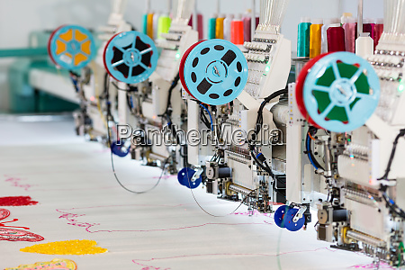 factory sewing machine makes color pattern