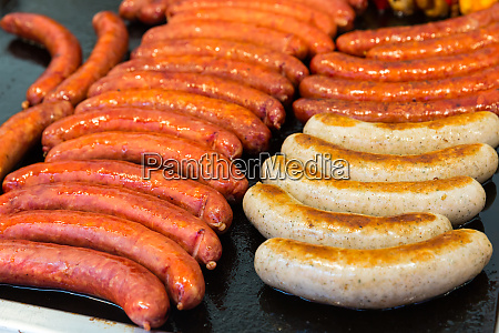 fresh sausages fried in a pan