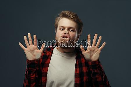 mans crazy face crushed on transparent