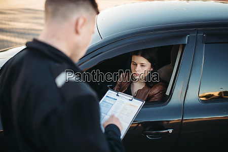 policeman in uniform writes fine to