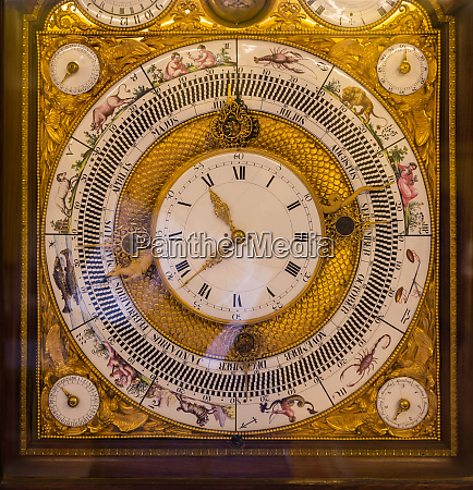 ancient clock with jewels in museum