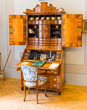 ancient wooden dresser in museum europe