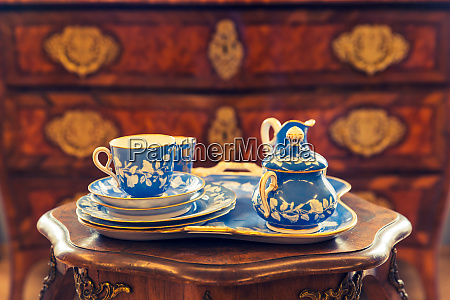 set of ancient tableware on wooden