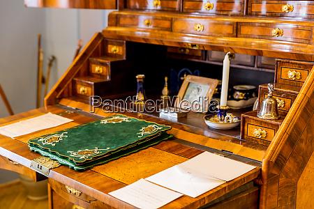 ancient wooden dresser in museum closeup