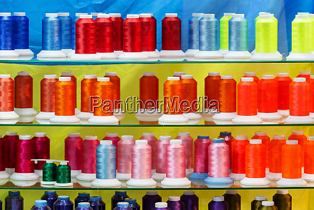 spools of new color threads sewing