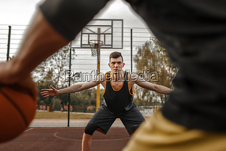 basketball players outdoor court active leisure