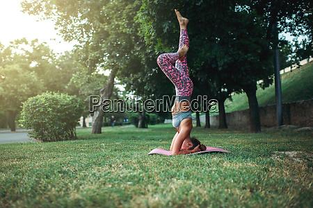 flexible woman yoga concentration exercise