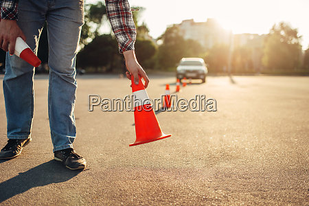 instructor sets the cone driving school