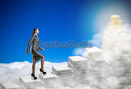 business woman walks through the stacks