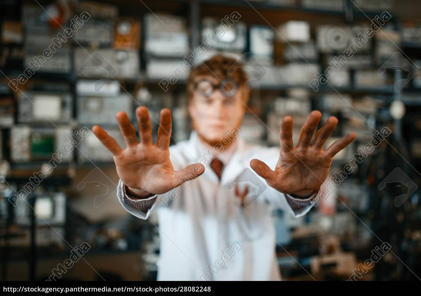 strange, scientist, showing, scorched, hands, in - 28082248