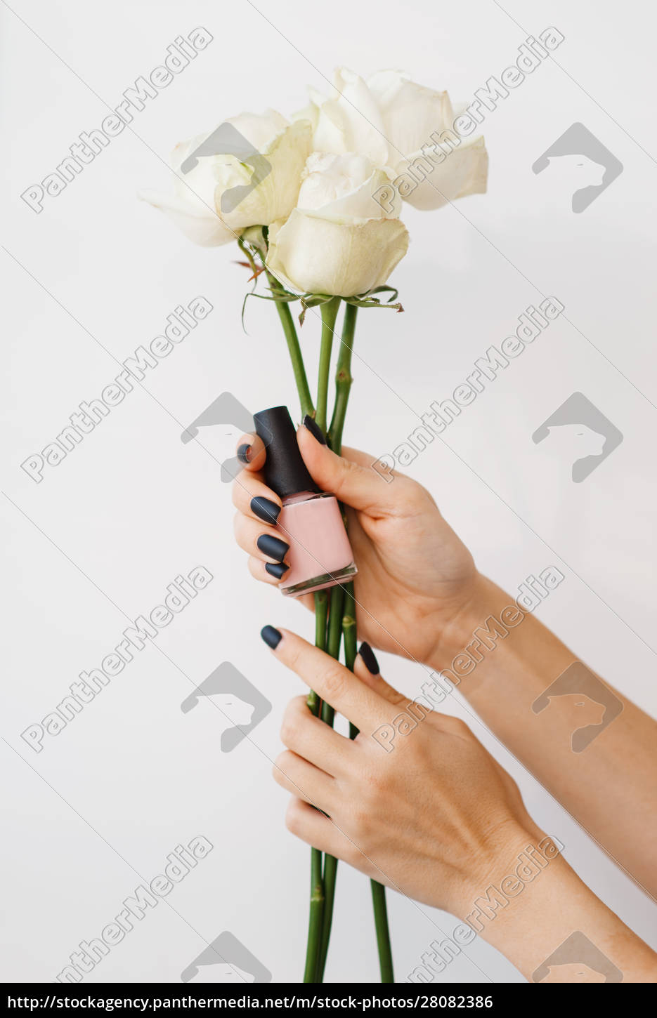 woman, holds, nail, varnish, and, flowers, - 28082386