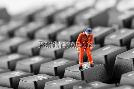 worker, looking, into, pit, in, keyboard - 28082544