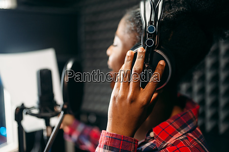 young, woman, songs, in, audio, recording - 28082424