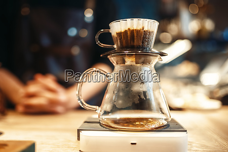 glass coffee pot stands on stove