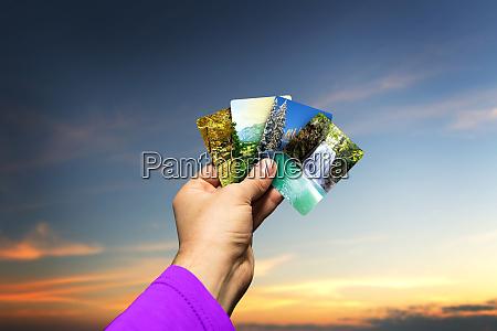 male hand lolding seasons cards